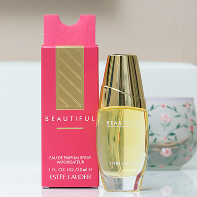 ESTÉE LAUDER<sup>&reg;</sup> Beautiful Eau de Parfum Spray - The fragrance of a thousand flowers, this romantic, luxurious scent combines a bouquet of violets and lilies, roses and lilacs, marigold and orange blossoms and is warmed with a rich, woody base and brightened with a touch of citrus.  Spray bottle contains 1 fluid ounce of perfume.